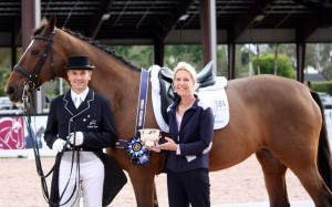 Ann-Louise Cook presents Lars Petersen with the first People's Choice Award of the 2015 Adequan Global Dressage Festival