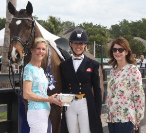 Ann-Louise Cook (left) presents the People's Choice Award to Shannon Dueck (middle), with Hanoverian gelding Cantaris owned by Elizabeth Ferber (right) at the Adequan Global Dressage Festival